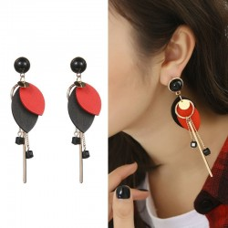 Long earrings with a wooden leaves & black beads