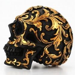 Czarna głowa czaszki - ze złotymi rzeźbami - posąg z żywicy