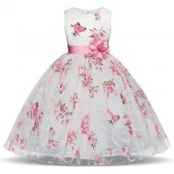 Lyxig tjejklänning - blommönster & rosett