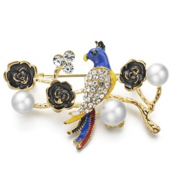 Broche con pàjaro flor y perla